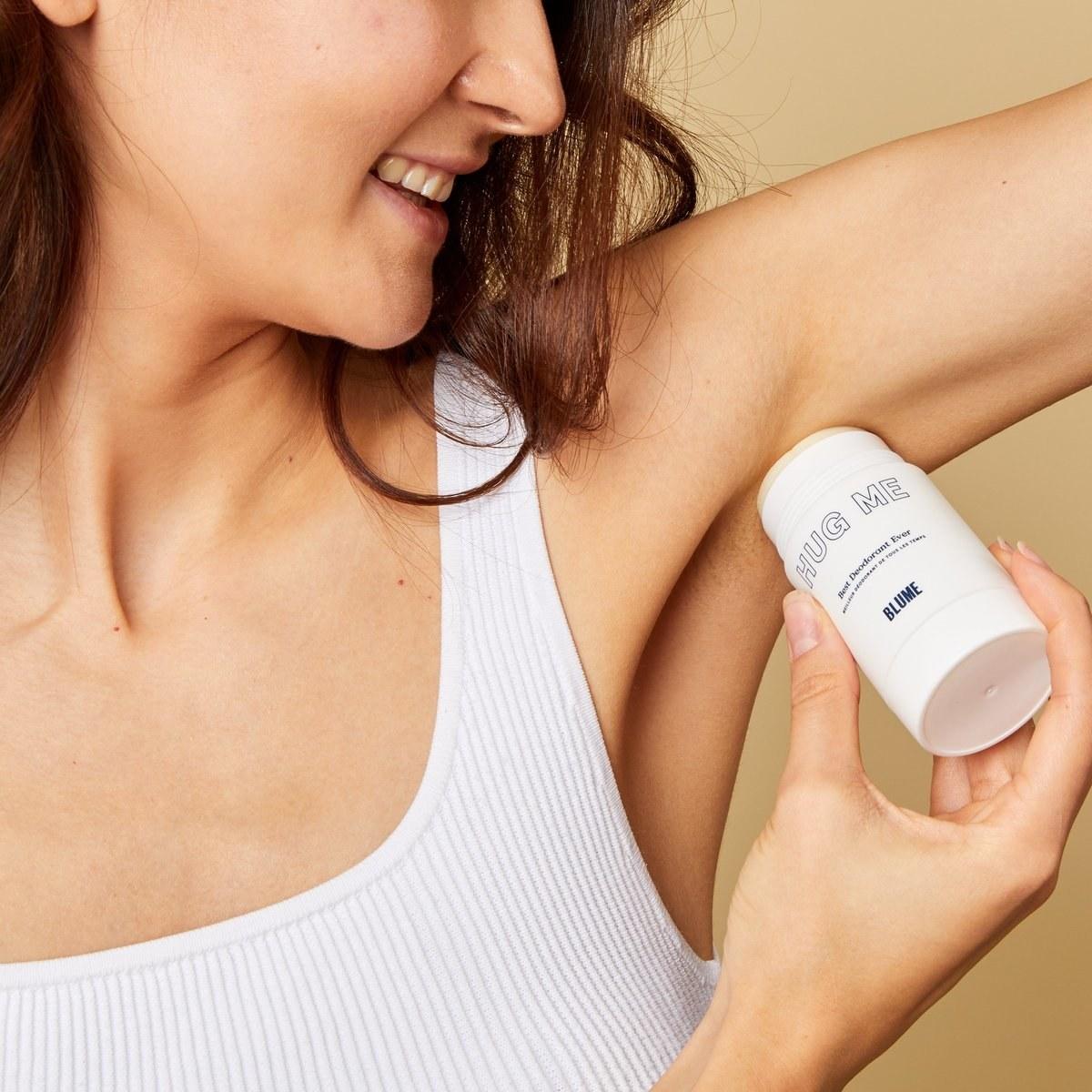 person applying the deodorant