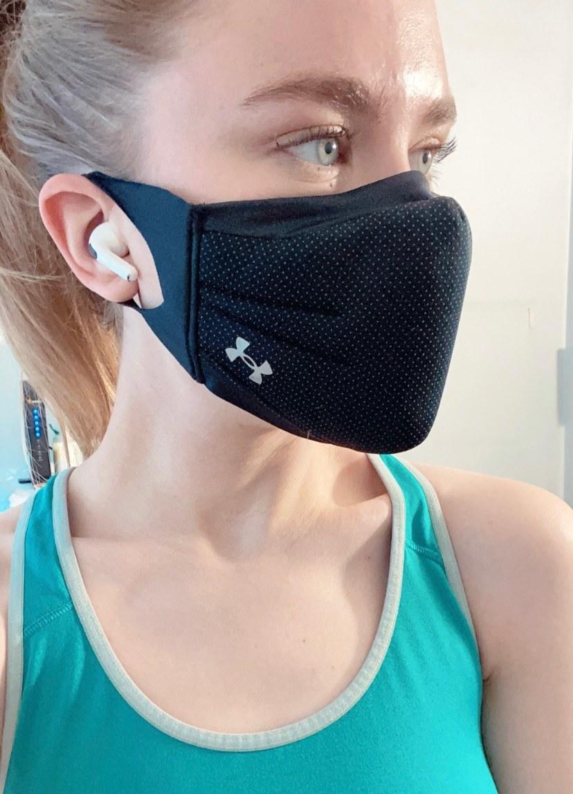 BuzzFeed editor in workout gear wearing AirPods Pro in ears