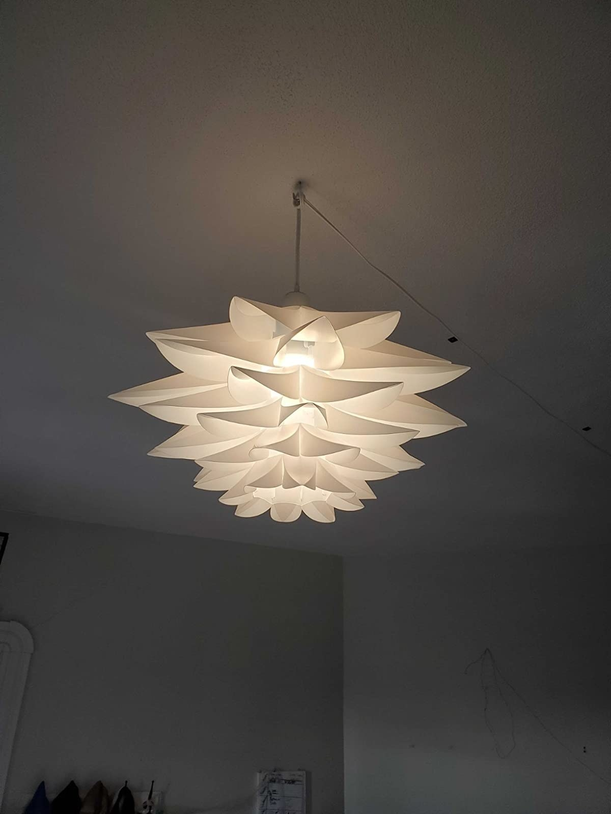 reviewer image of the lotus pendant light hanging from the ceiling