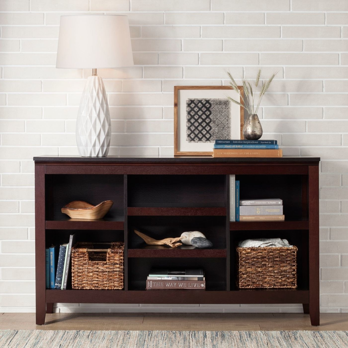 console table with two wicker milk crates on the shelves