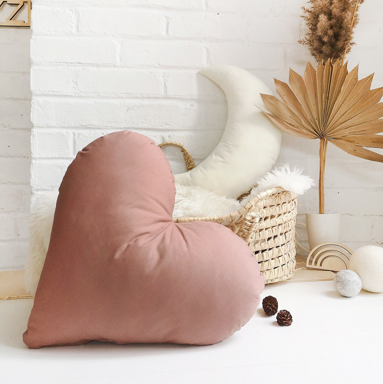 A heart-shaped pillow in a kid's room