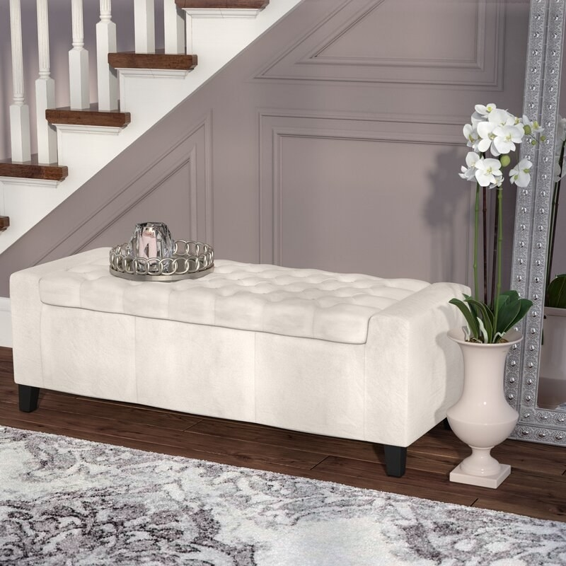 An upholstered flip top storage bench for sitting and easy storage space