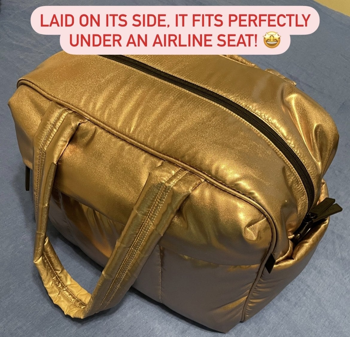 """the duffel in gold captioned """"laid on its side it fits perfectly under an airline seat"""""""