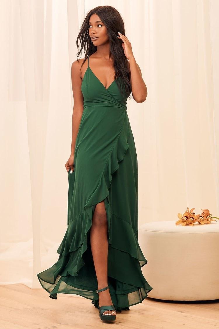 model wearing the V-neck emerald green dress