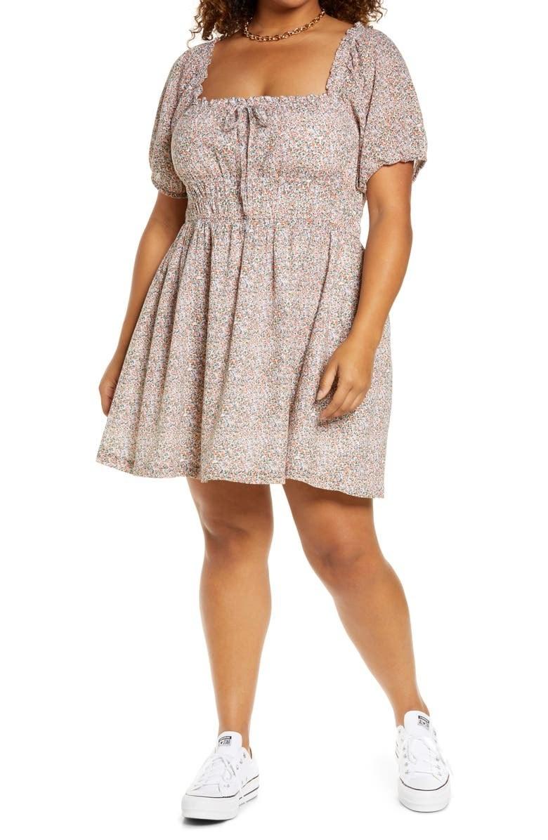 model wearing puff sleeve dress