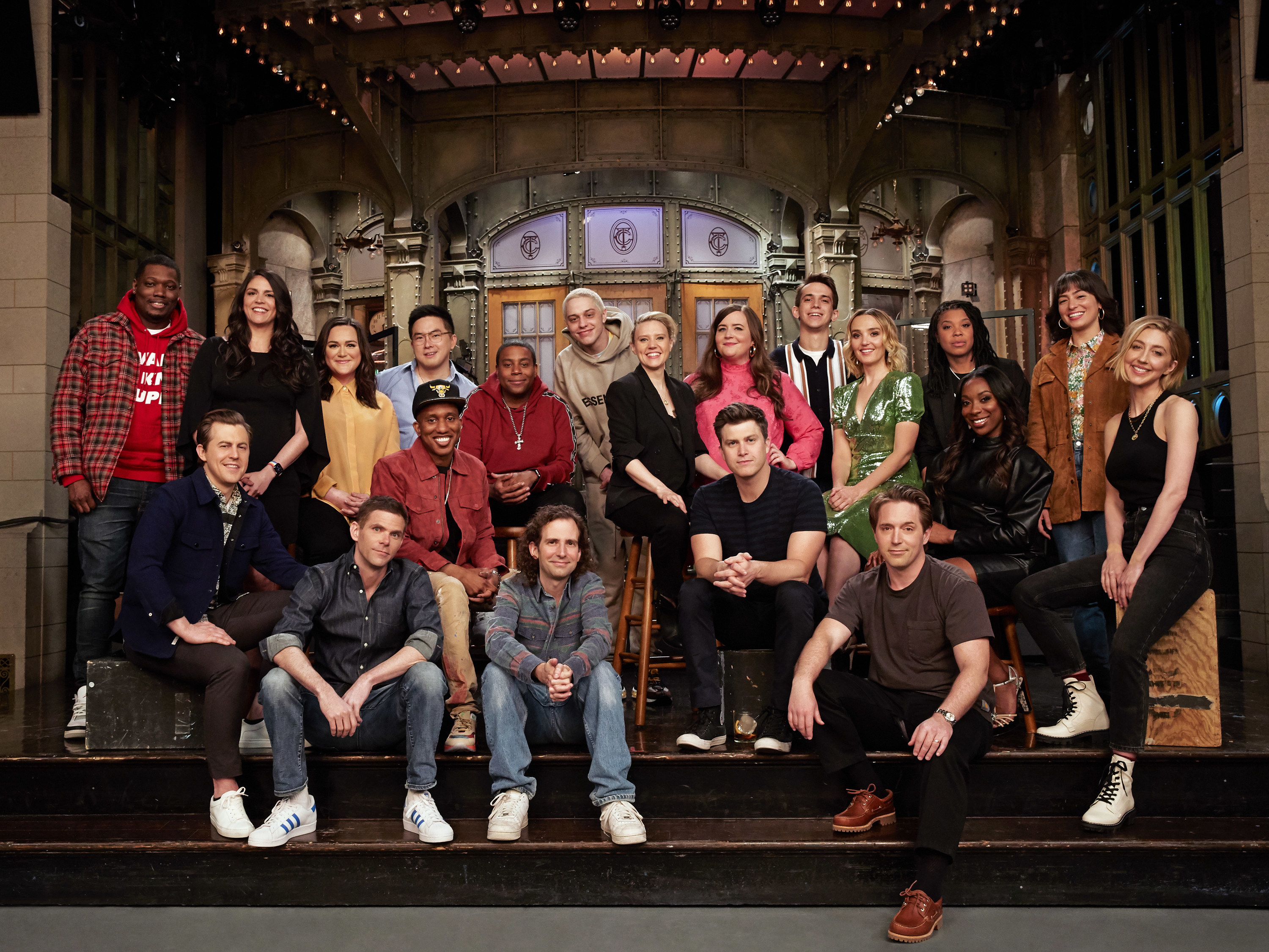 The entire cast poses for a photo on stage