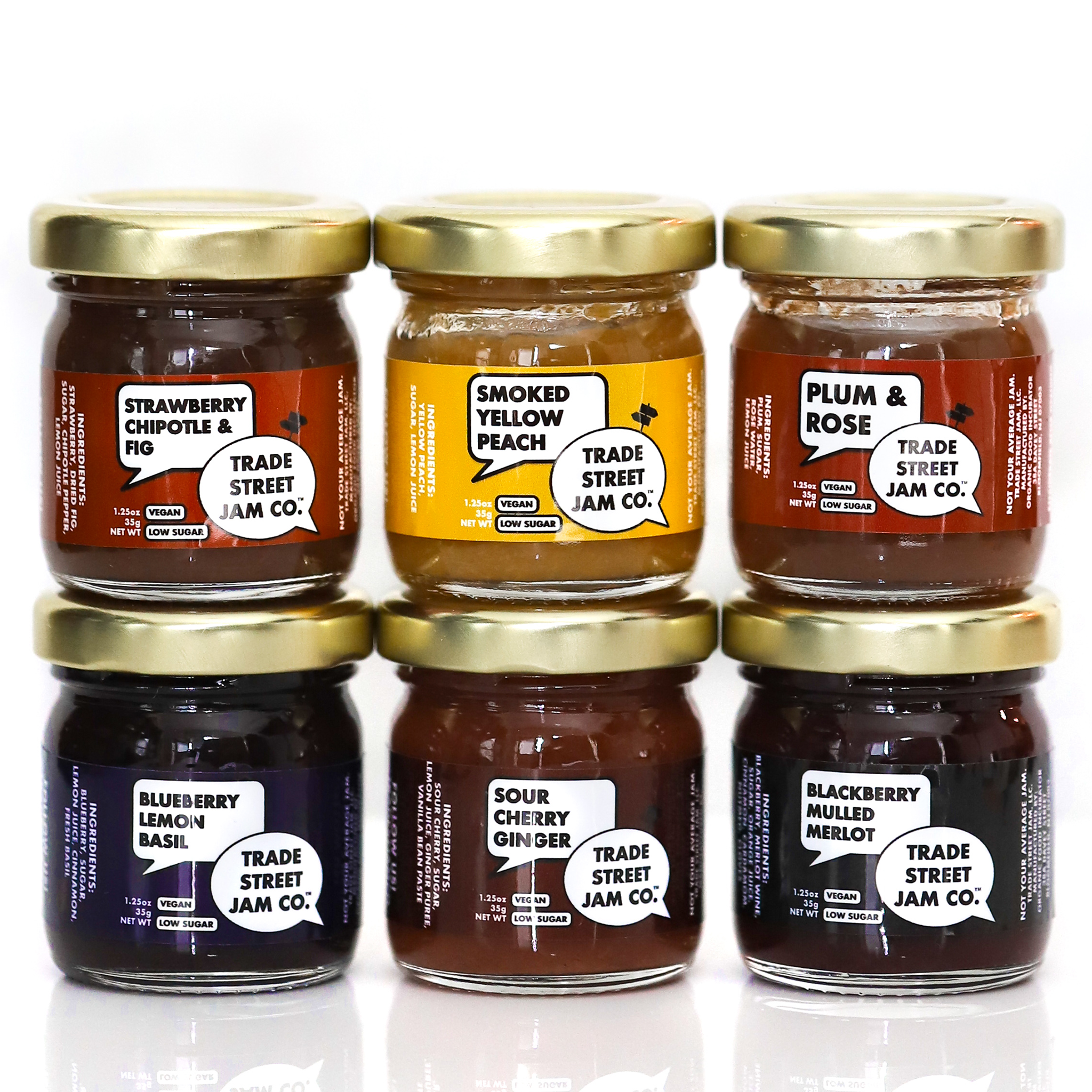 The jam jars with the respective titles of each jam on the front with the bran's logo
