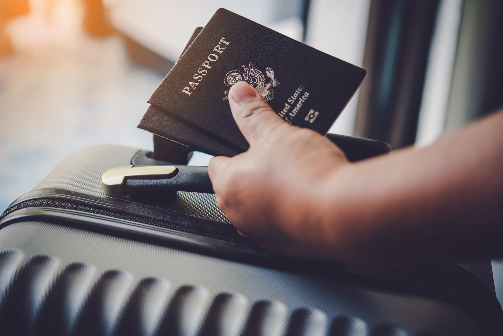 At the airport with luggage and passports in hand