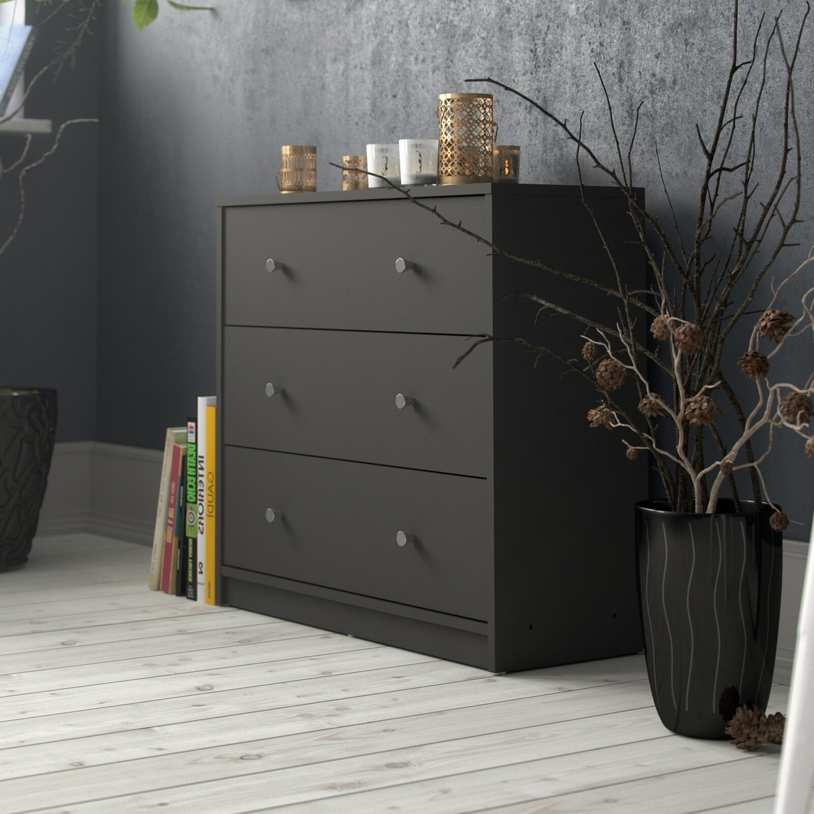A wooden, three-drawer dresser that slides open,  and can store clothing of all kinds