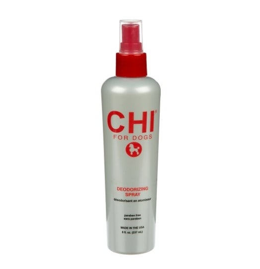 The deodorizing dog spray in a gray bottle with red lettering