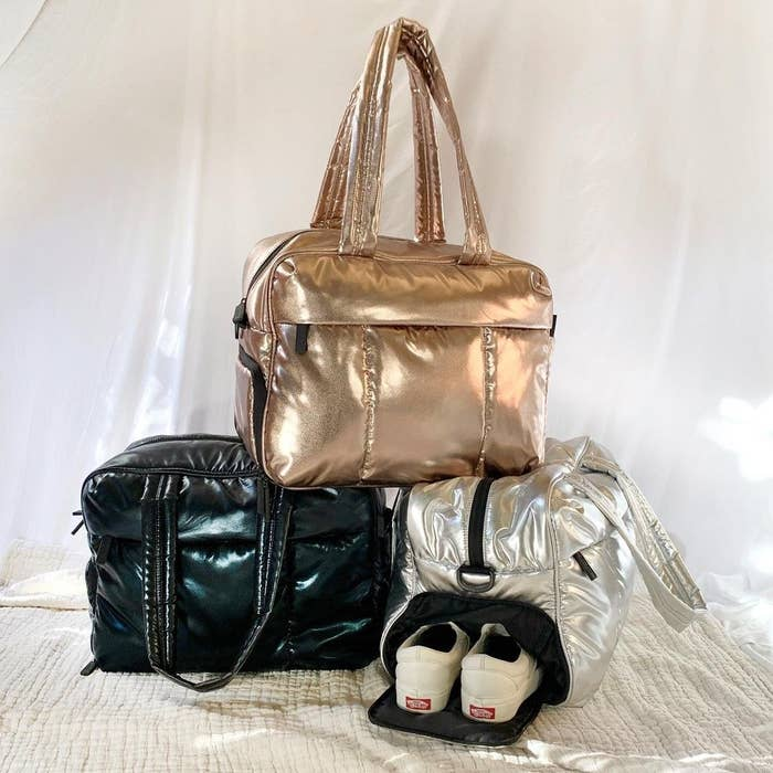 rectangular duffel in metallic silver, gold, and black, one with a show pocket open with Vans inside