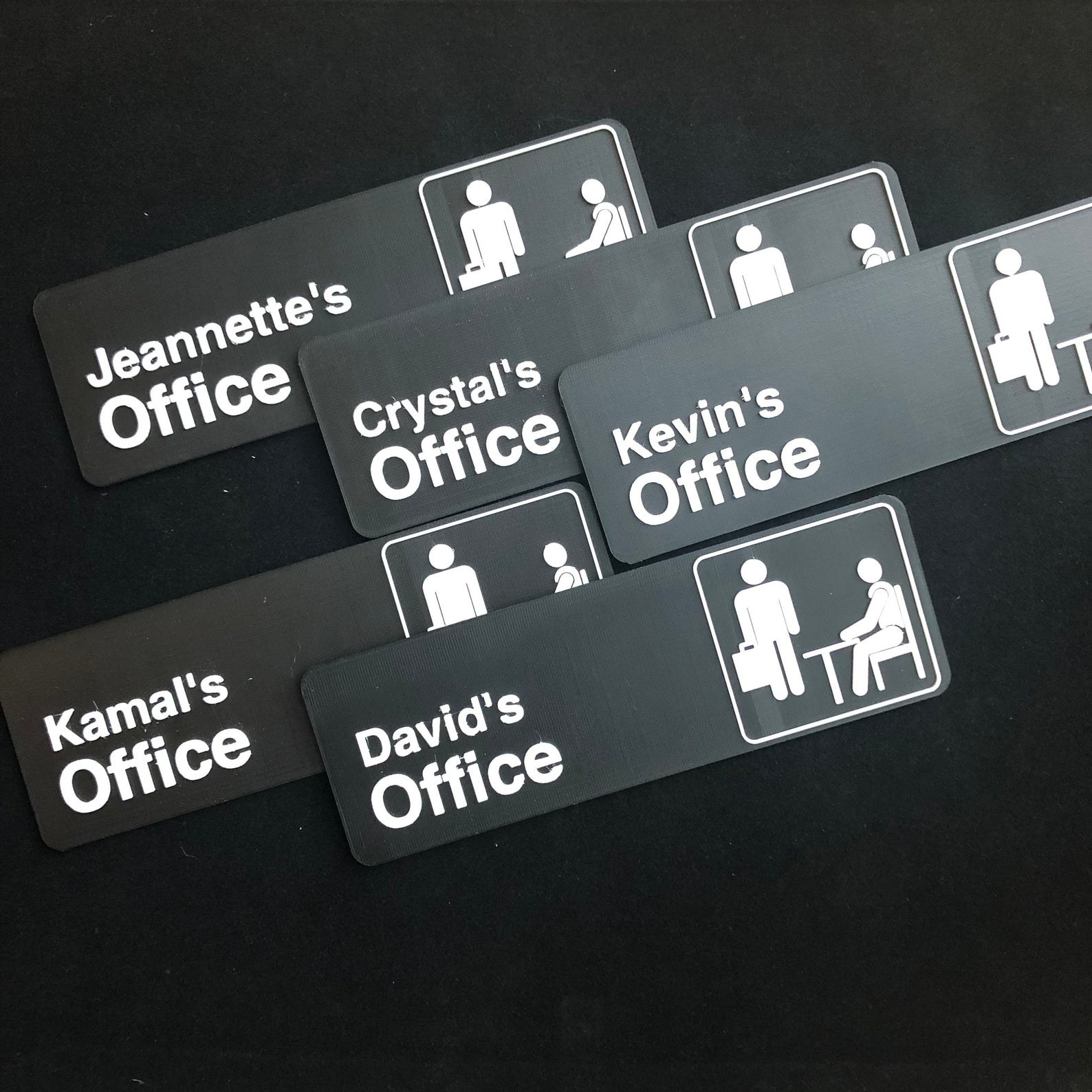 The Office door signs with people's names on them like Kamal's Office and Crystal's Office