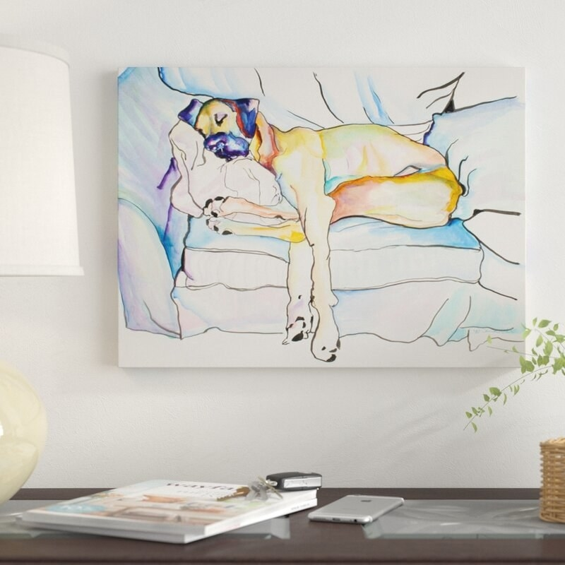 A hangable canvas print of a dog sleeping that can be placed onto walls