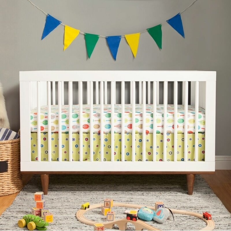 A solid wood 3-in-1 convertible crib that can be used as a crib, toddler bed, and daybed