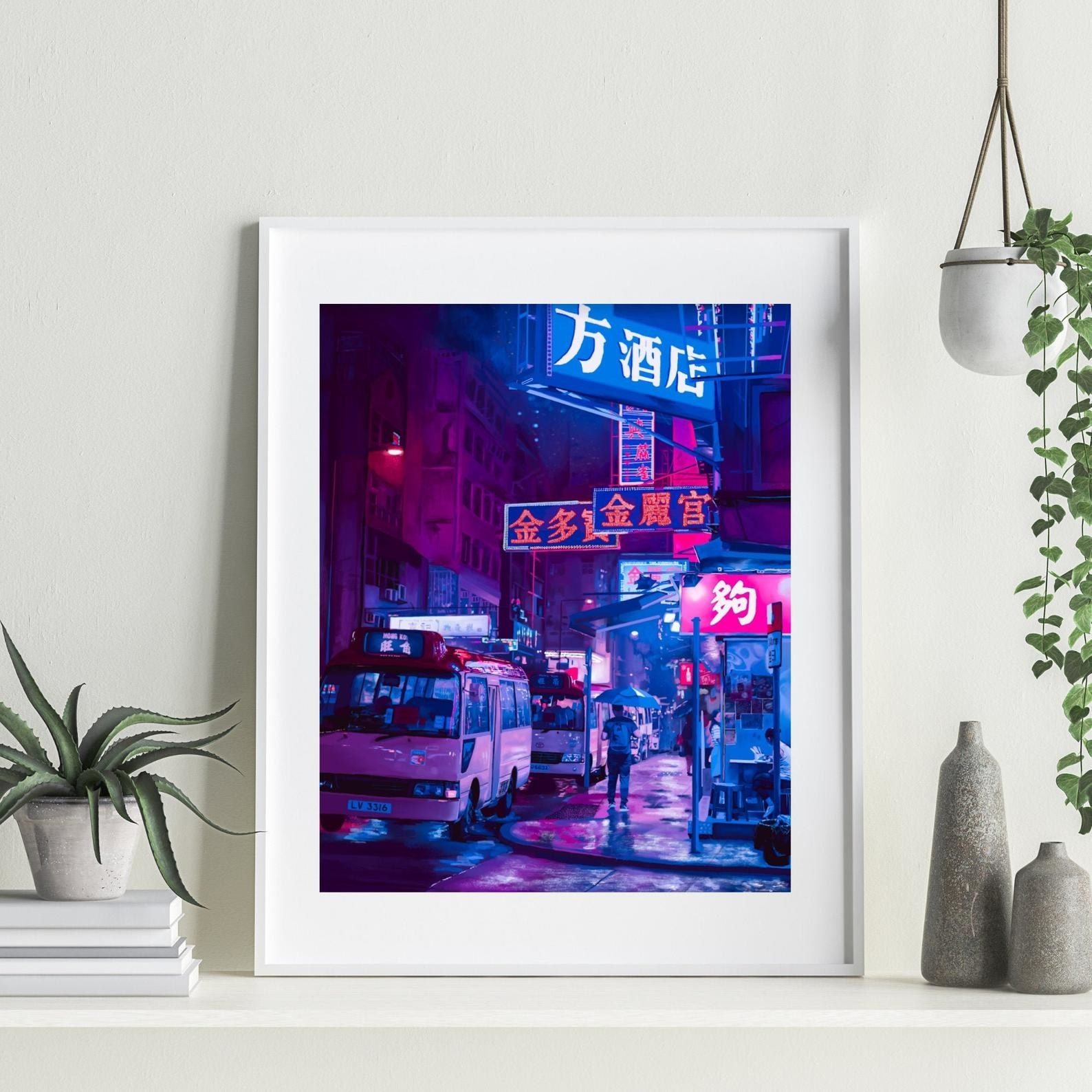 the print in a frame on a shelf