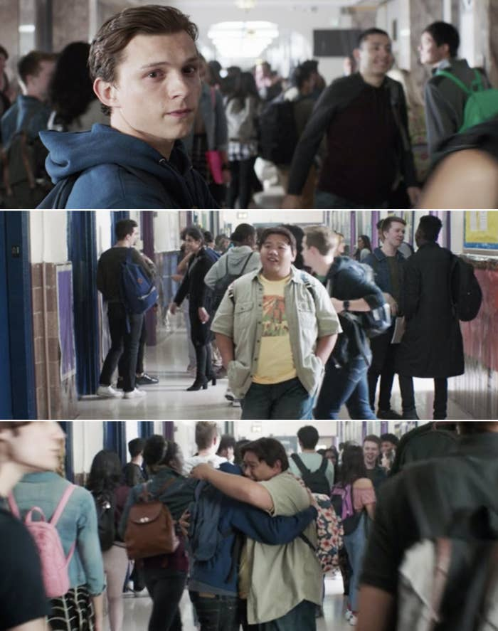 Peter and Ned hugging in the school hallway