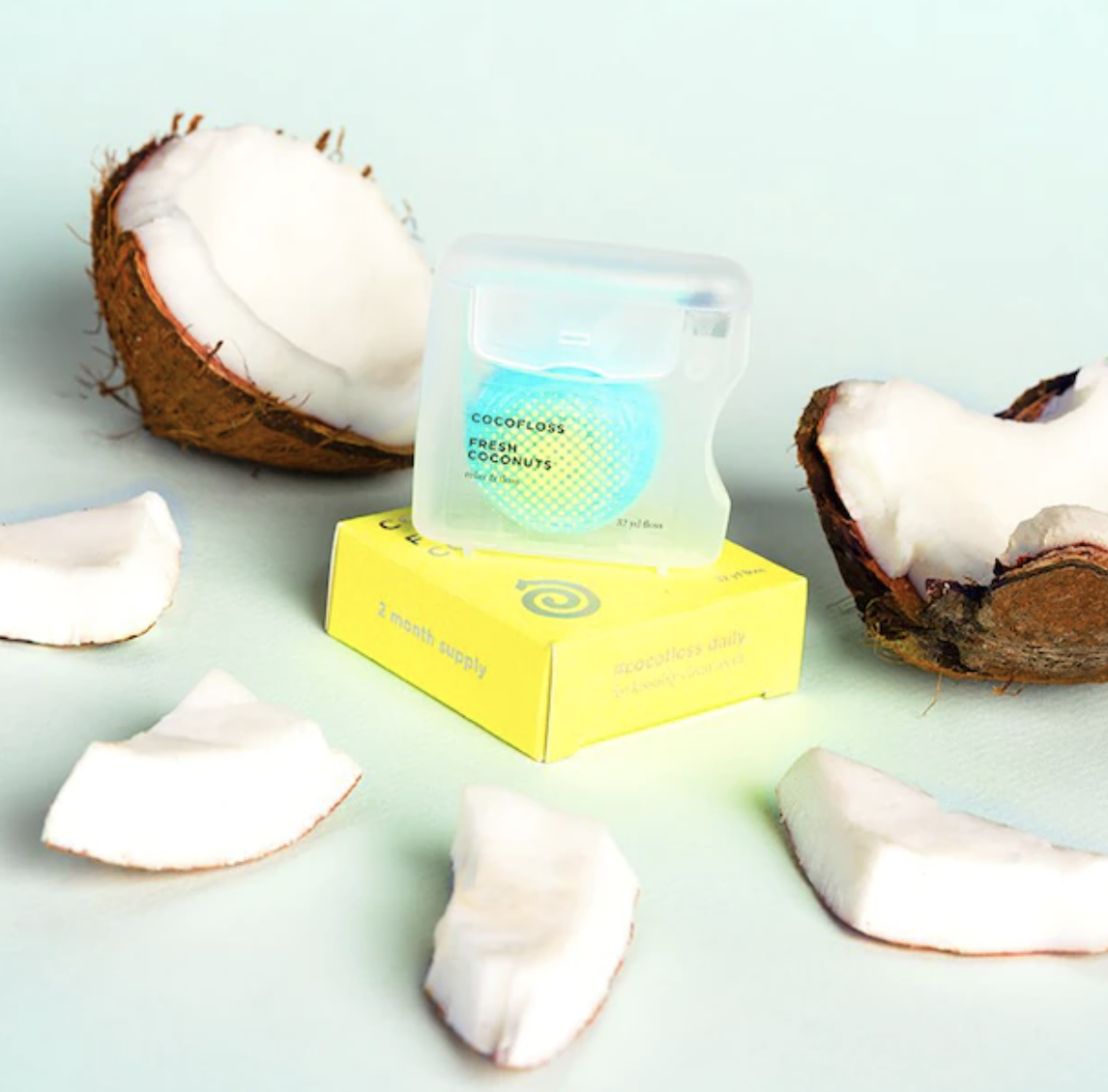 the floss on a box next to coconut pieces