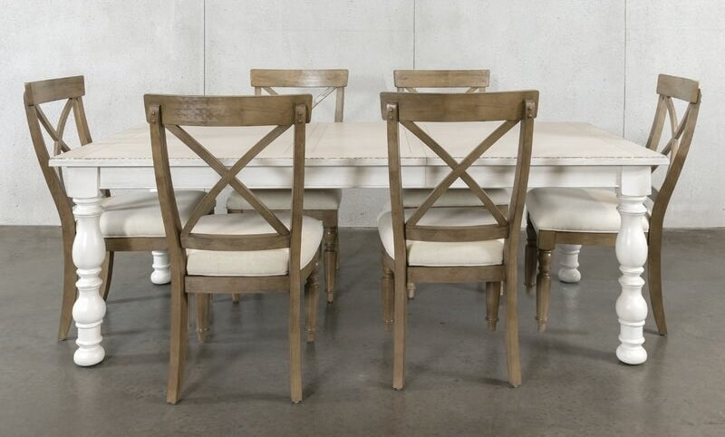 A seven-piece, extendable dining set that features one extendable dining room table, and six driftwood dining room chairs