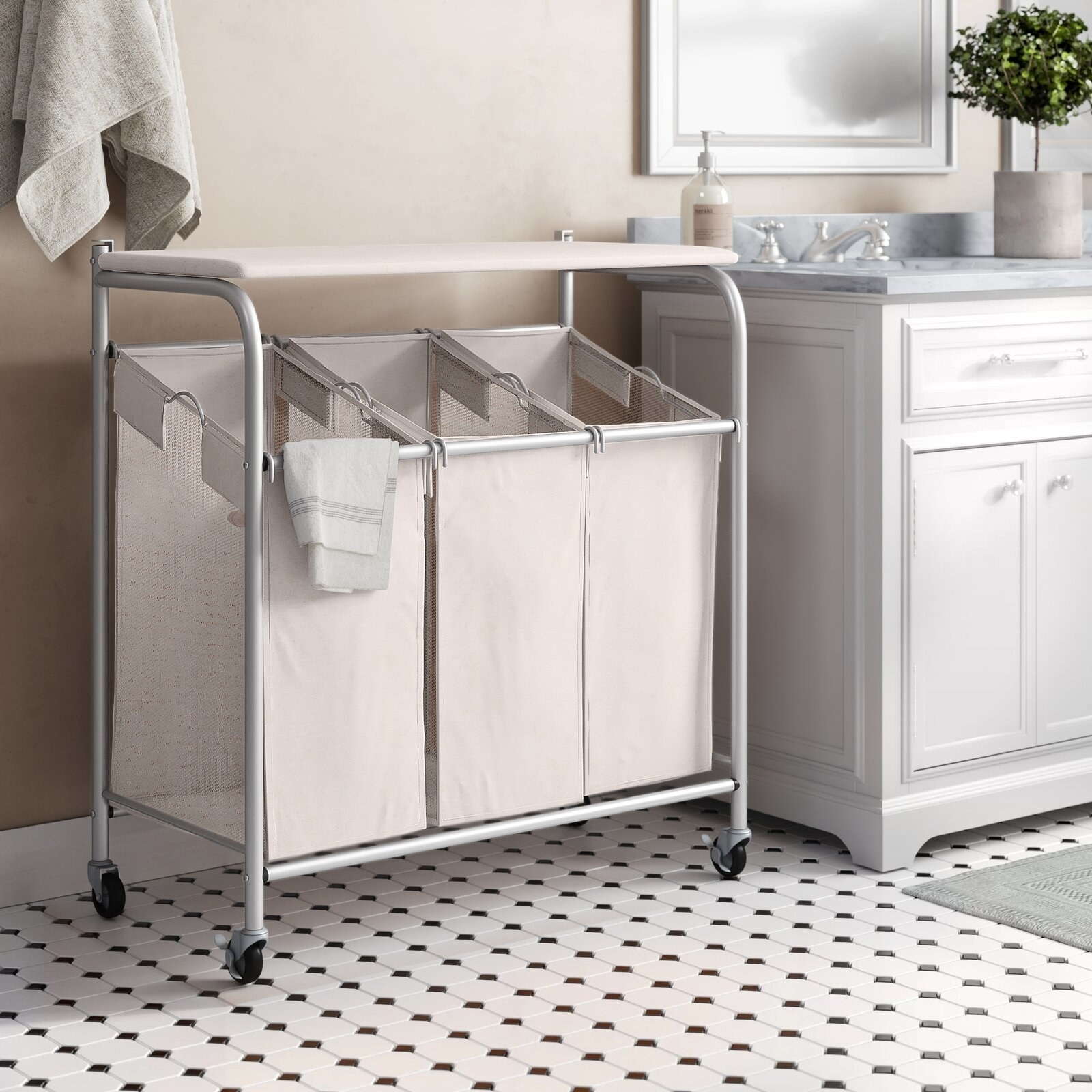 A three-bag laundry hamper, with wheels, and an iron-board top that can store both clean and dirty clothes in your laundry room