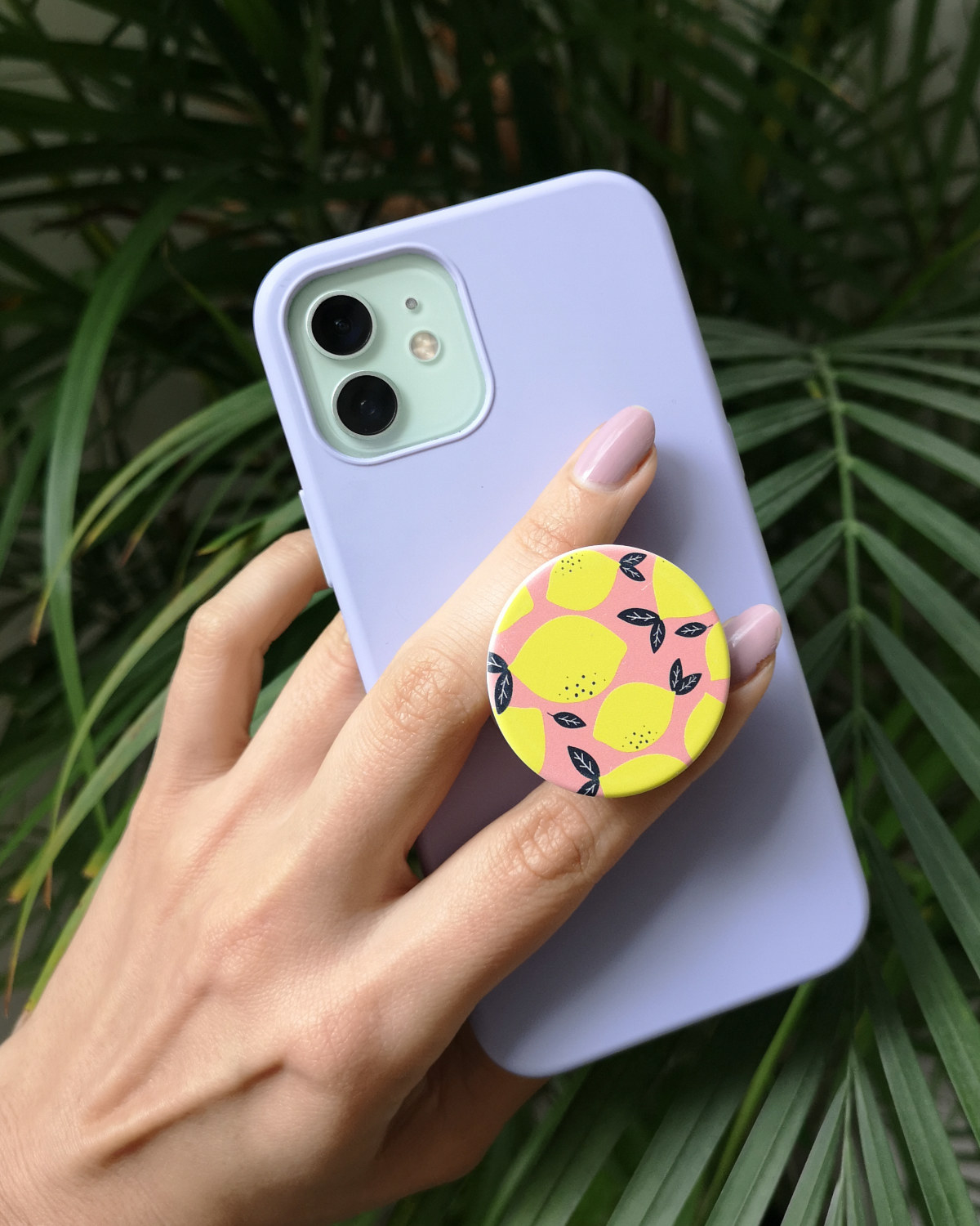 Brittany holding her iPhone 12 with the lemon-patterned popsocket