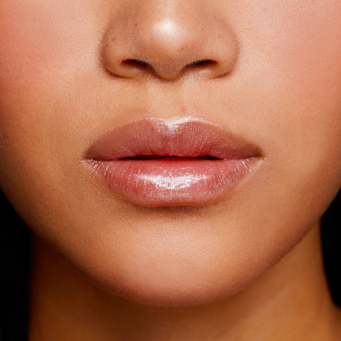 person's lips with the gloss on