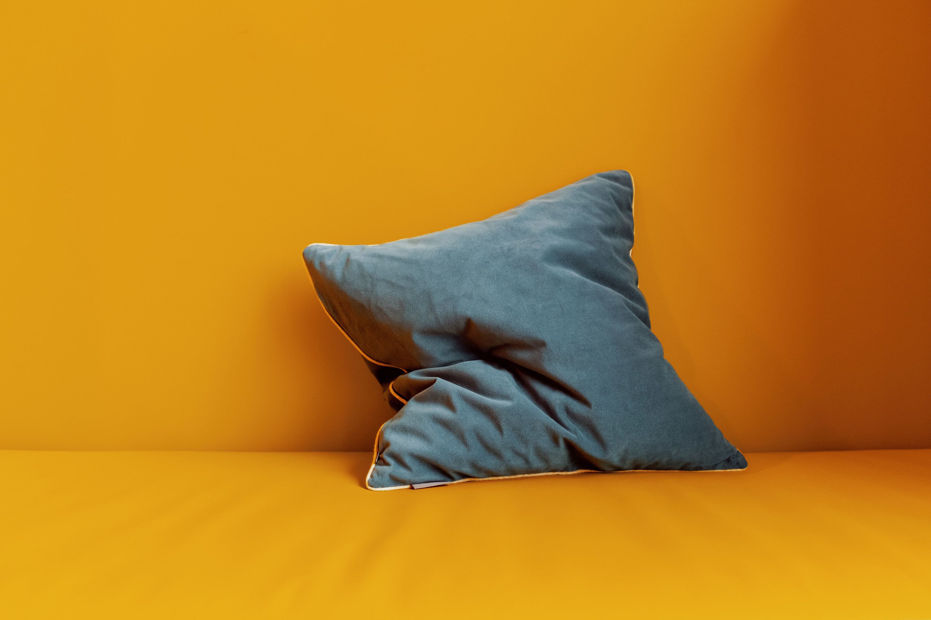 An image of a pillow on an orange background
