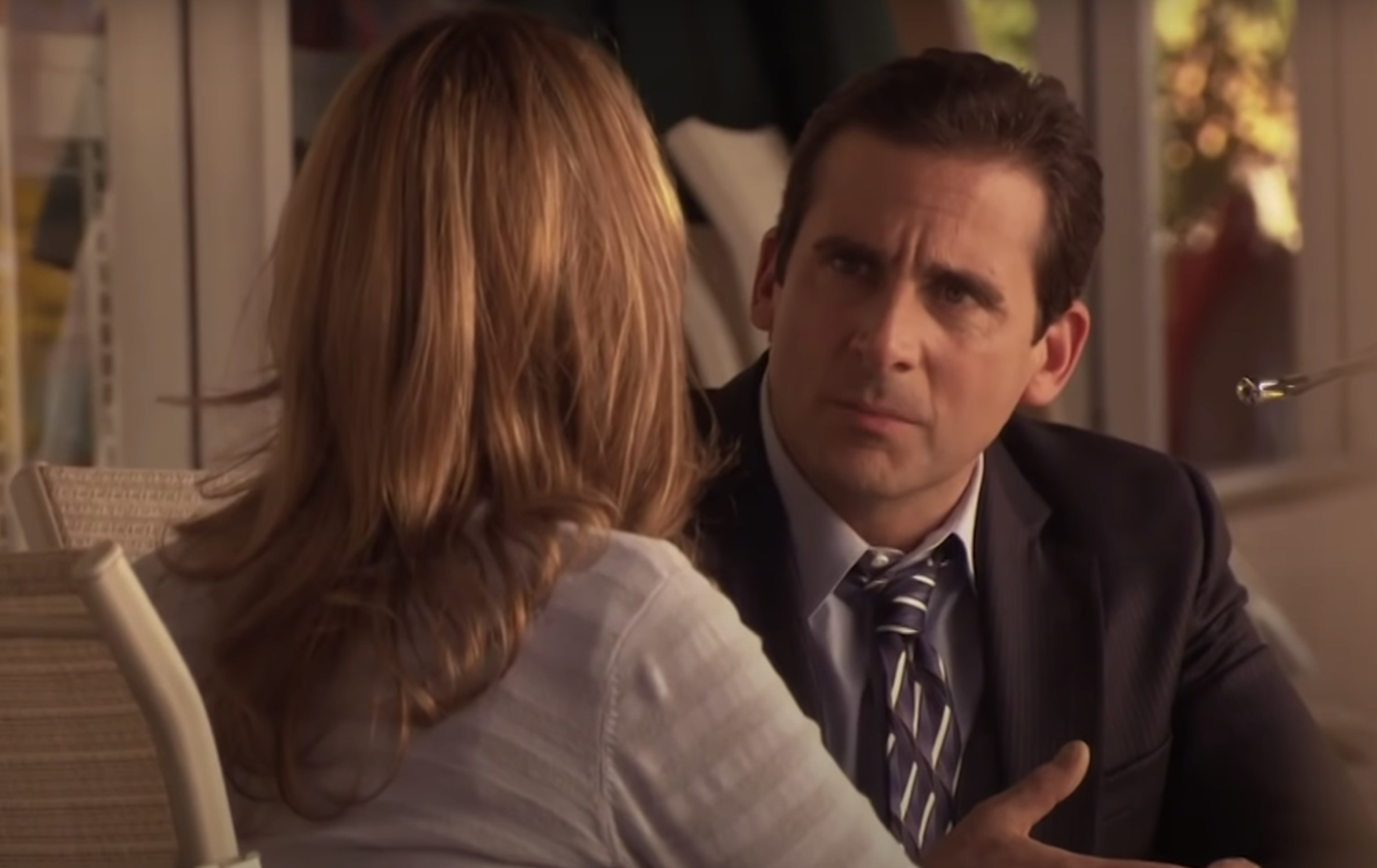 Michael looks at Jan while she talks about her pregnancy