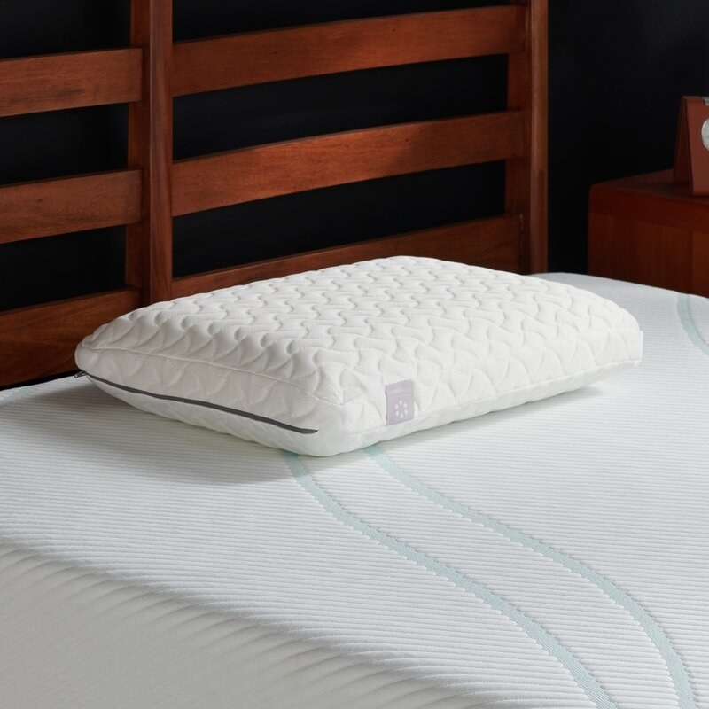 A thick sleeping pillow that provides support to head, neck, and shoulder areas