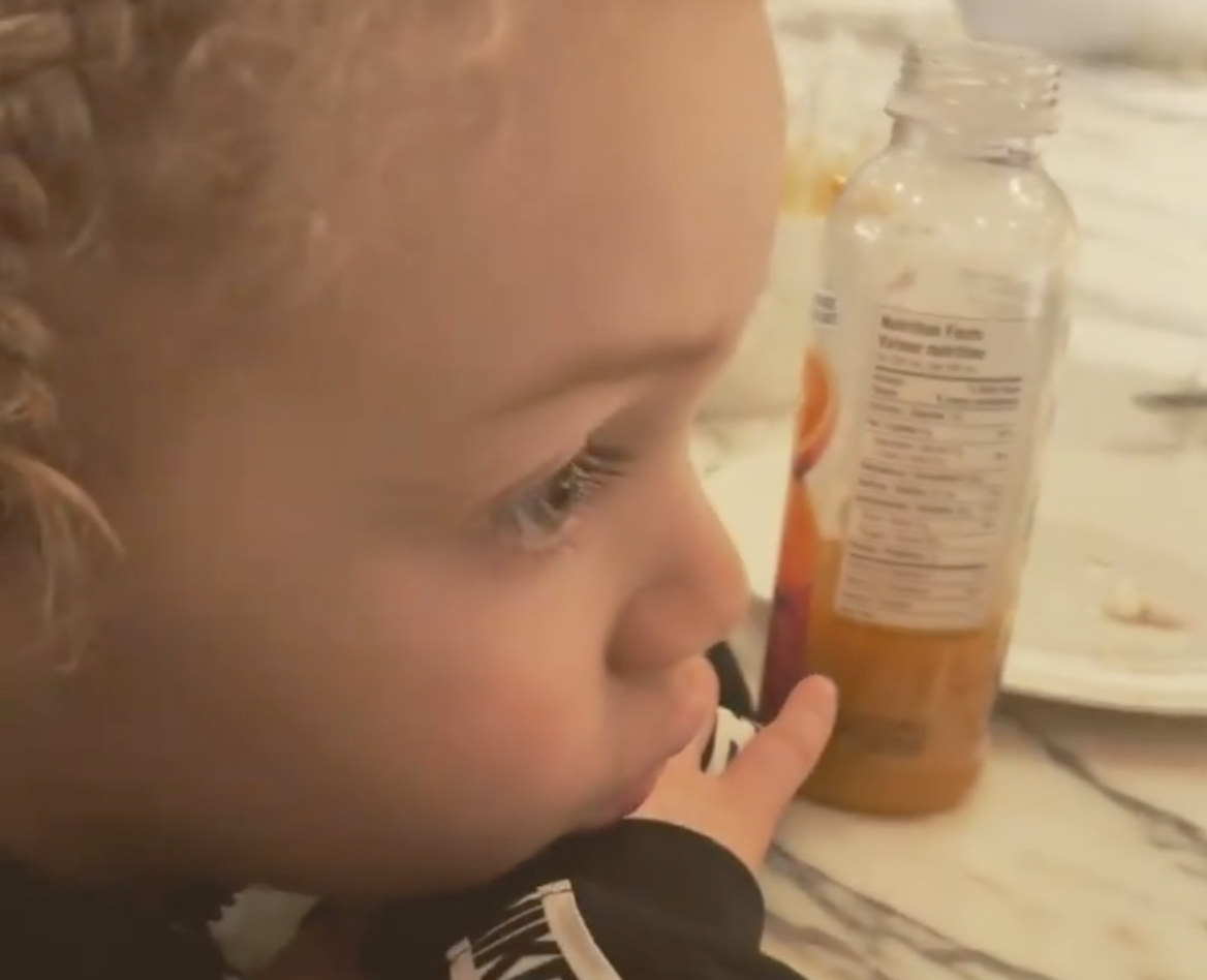 Drake's son Adonis watching highlight clips of Lebron James playing basketball