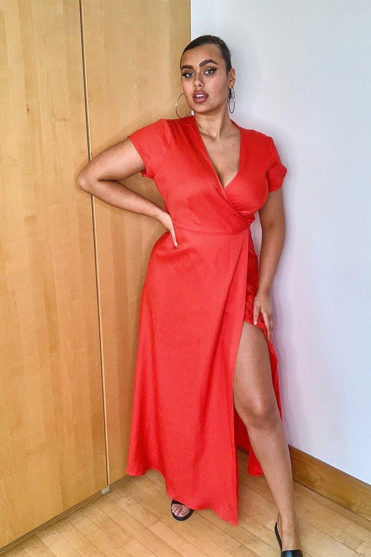 model wearing red V-neck dress with slit