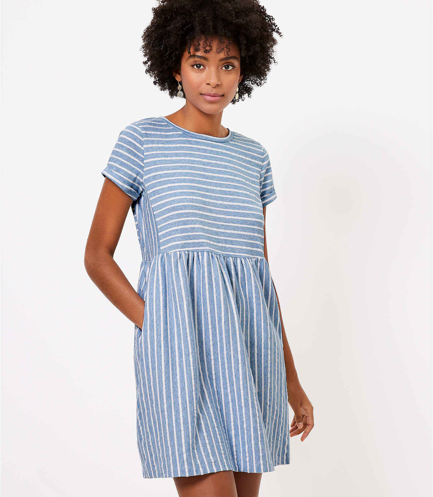 model wearing blue and white striped dress
