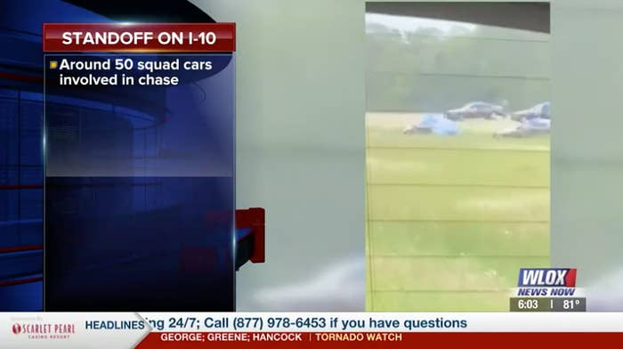 """A caption in a news broadcast reads """"Standoff on I-10, around 50 squad cars involved in chase"""""""