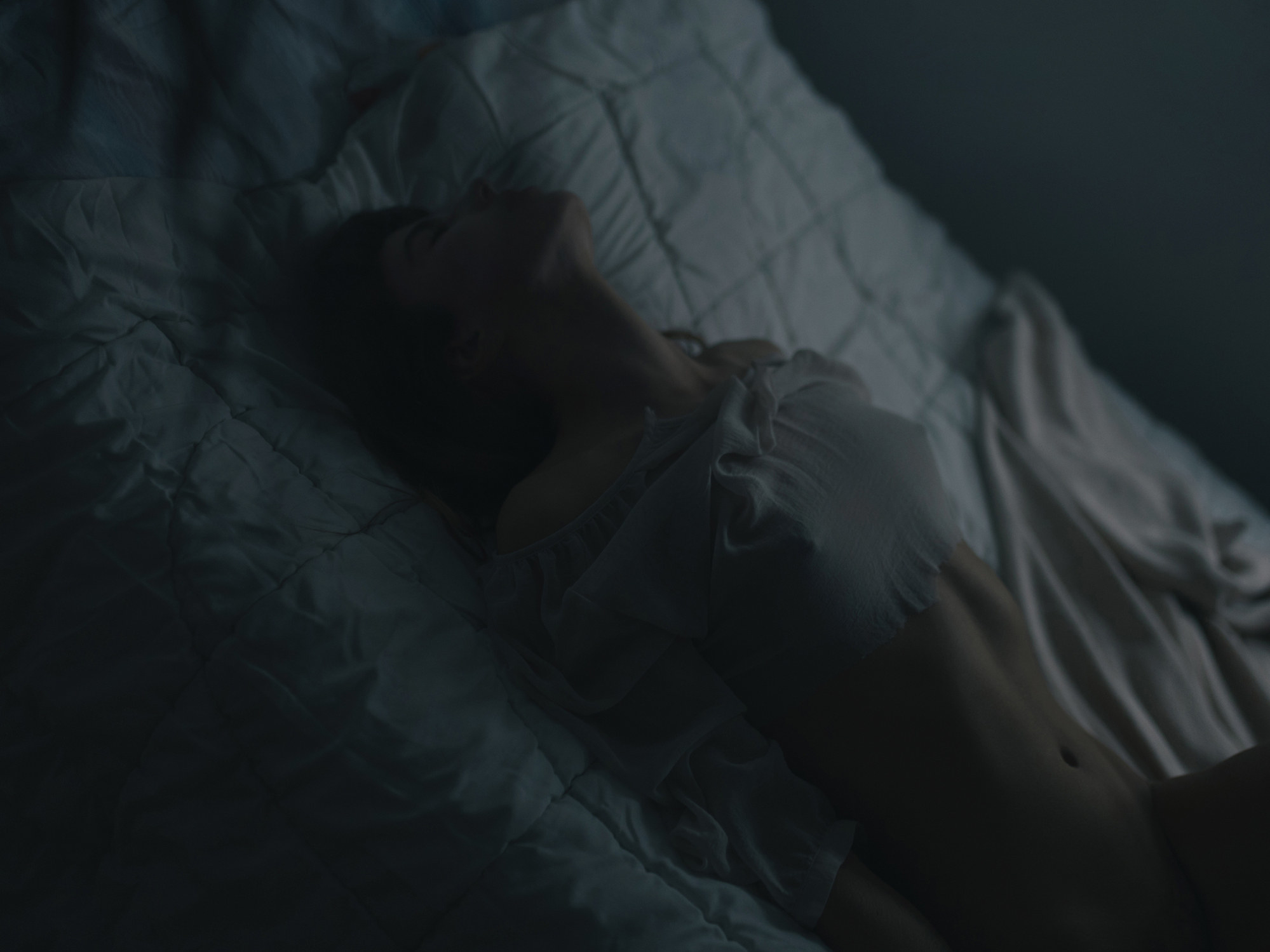 An image of a half-naked woman on a bed