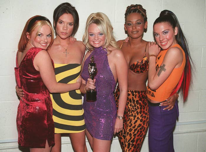 The Spice Girls pose together while holding an award