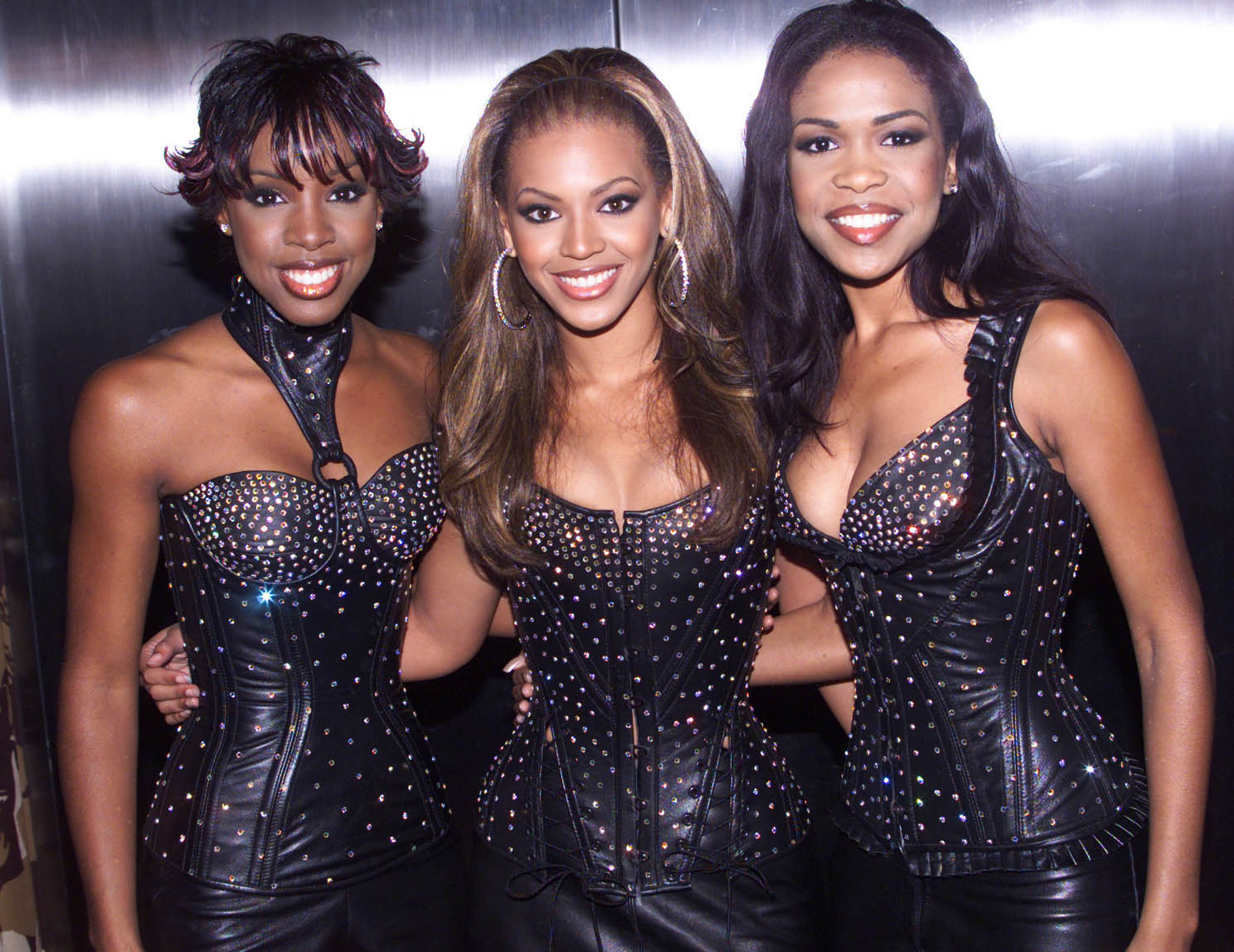 Beyoncé poses with her fellow Destiny's Child members in the early 2000s