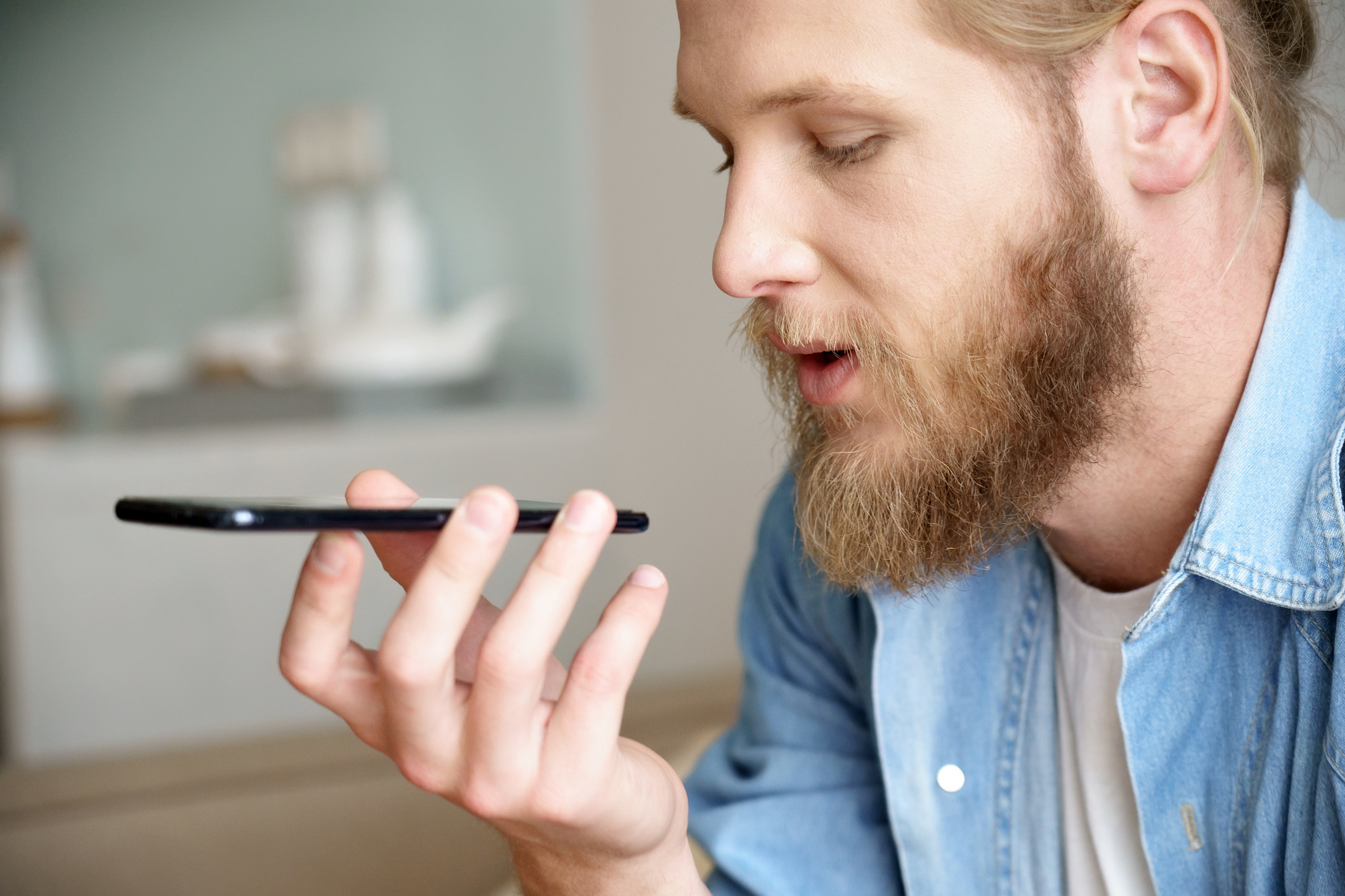 Guy with bearded holding phone