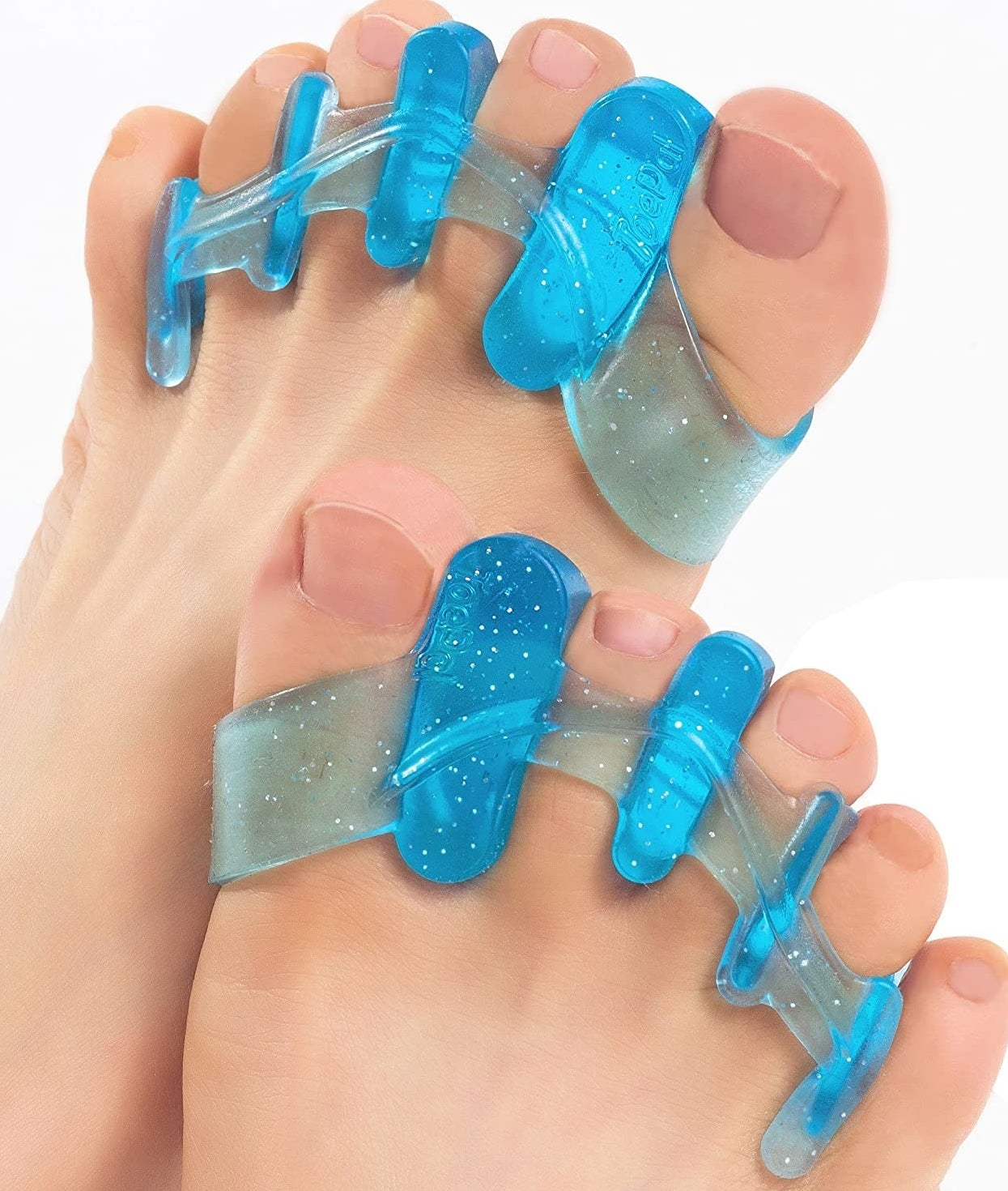 Two feet with a pair of gel separators between each toe