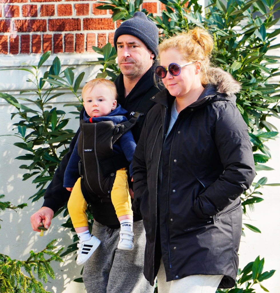 Amy Schumer (R) and Chris Fischer take baby Gene Fischer out for some morning air