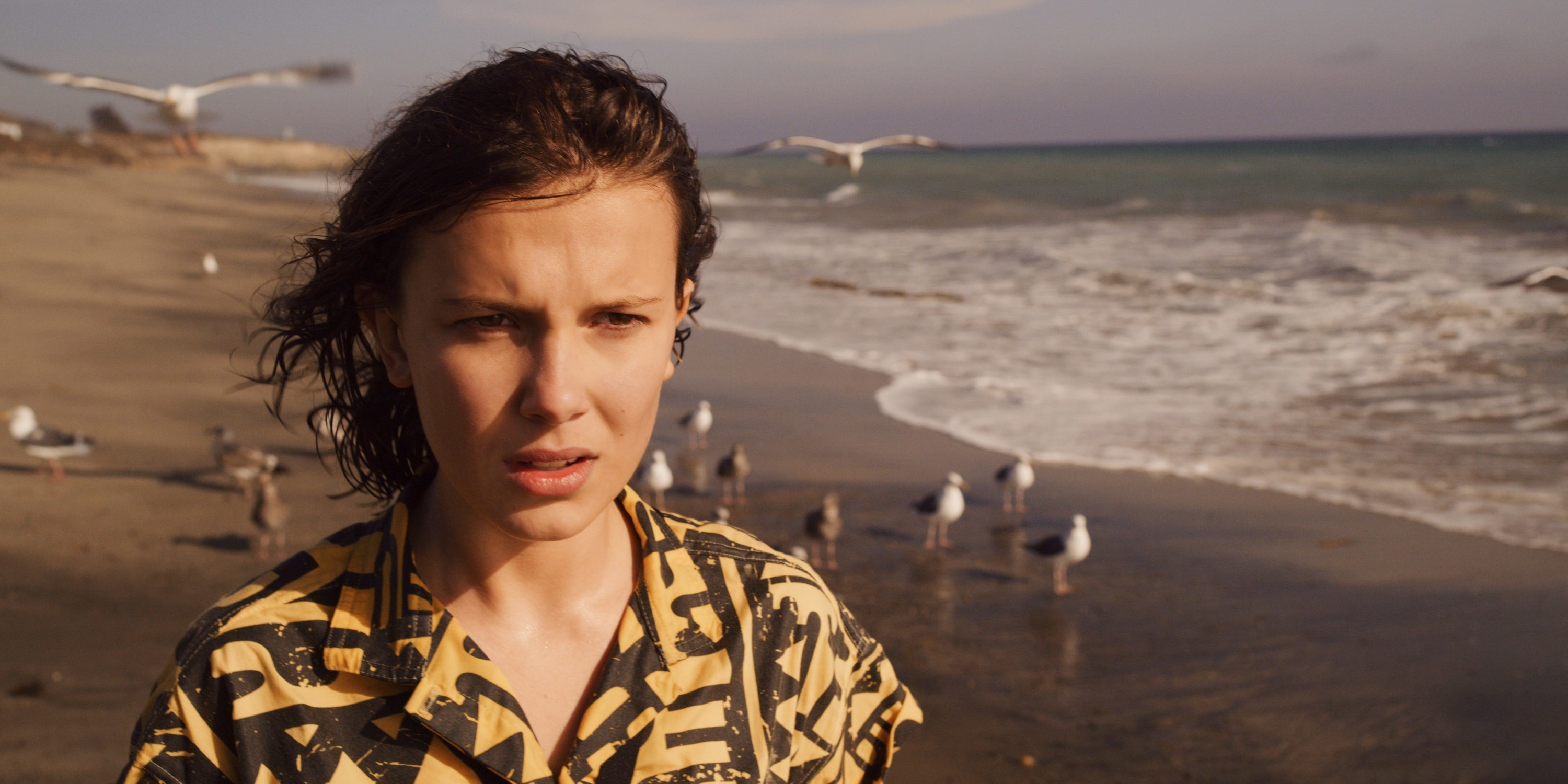 Eleven standing on a beach