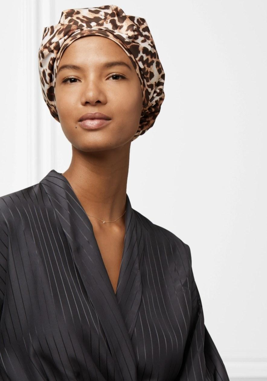a model wearing a leopard shower cap
