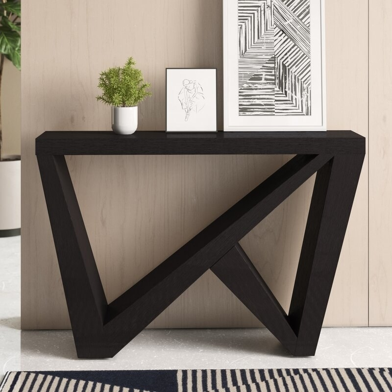 Black table with triangular cut outs and rectangular top
