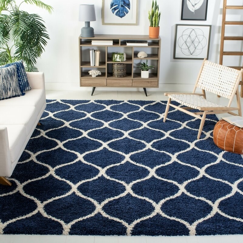 Navy rug with off white geometric shapes