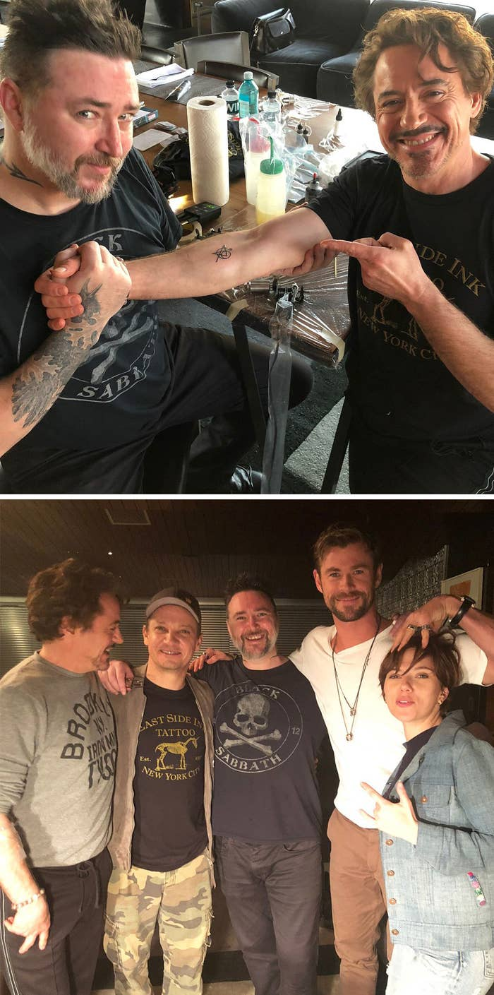 Robert Downey Jr. showing off his Avengers tattoo and Robert, Jeremy Renner, Chris Hemsworth, and Scarlett Johansson hanging with their tattoo artist