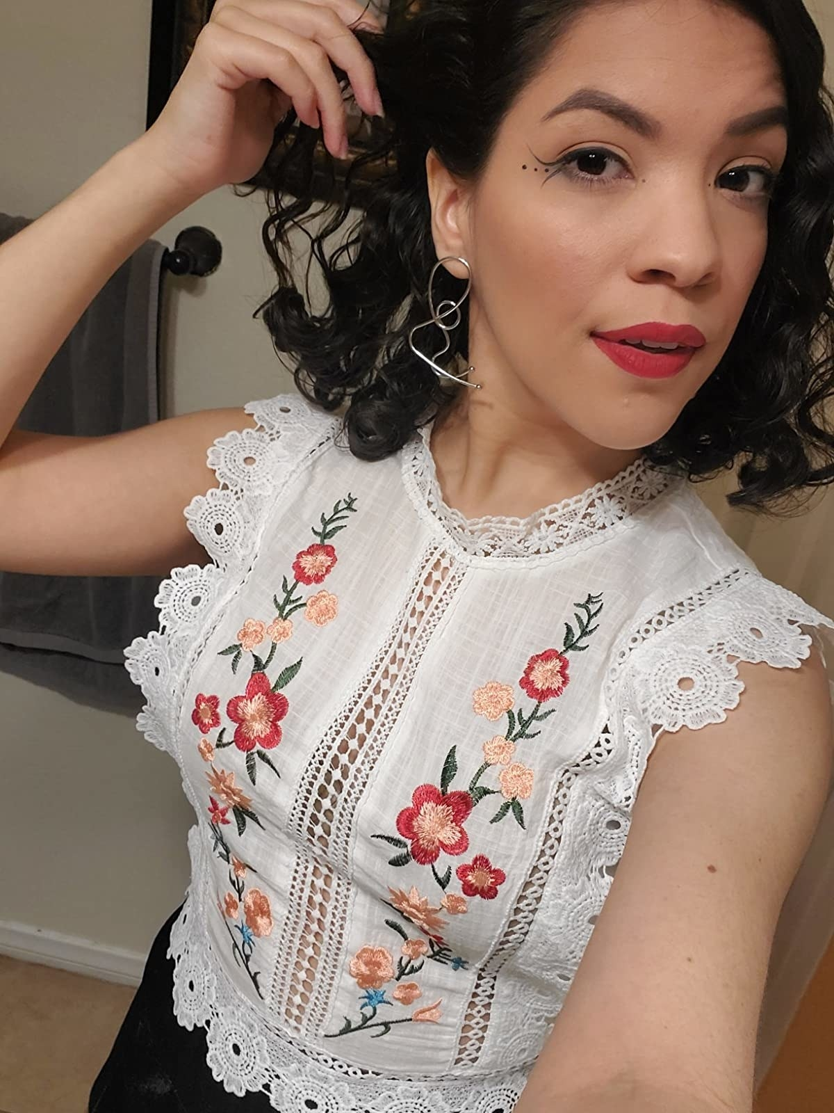 reviewer wearing the embroidered top
