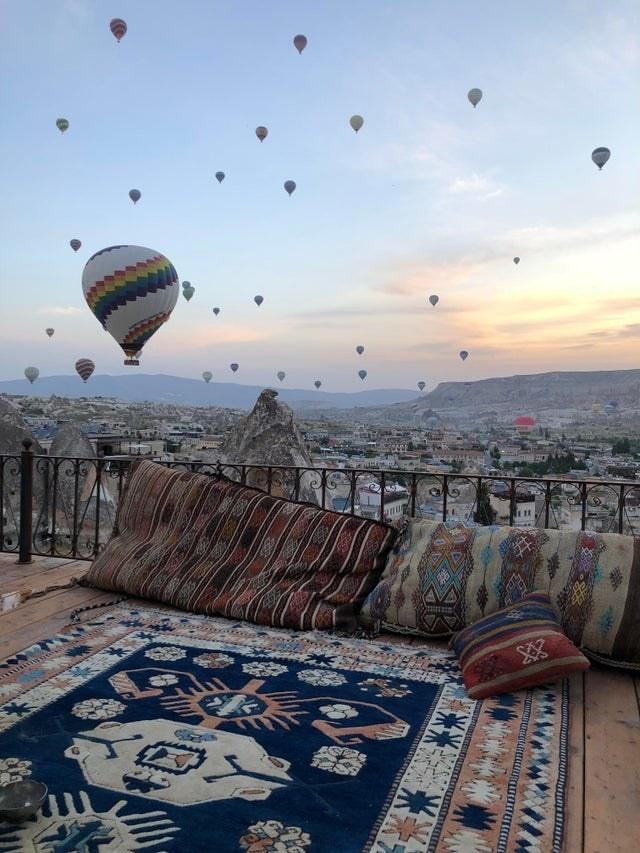 Hot-air balloons flying at sunrise in Cappadocia, Turkey