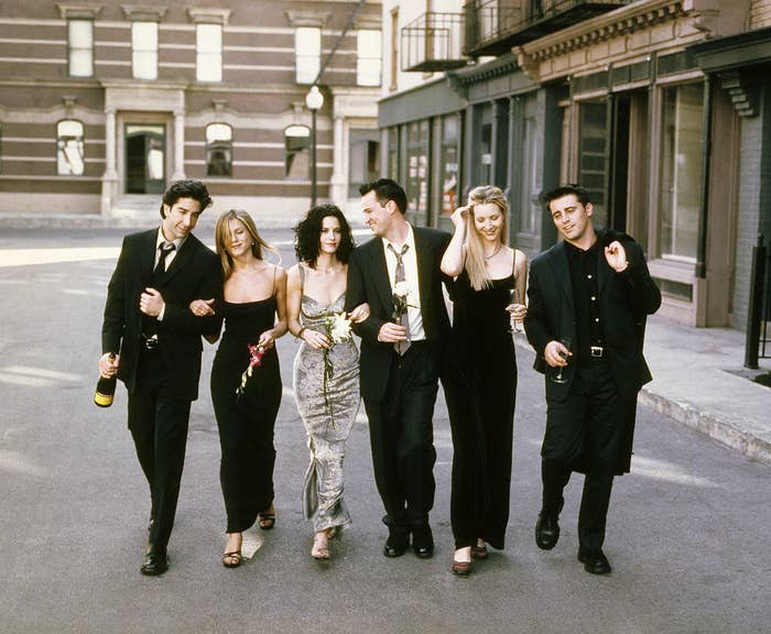 "David Schwimmer, Jennifer Aniston, Courteney Cox, Matthew Perry, Lisa Kudrow, and Matt LeBlanc walking arm in arm for the ""Friends"" Season 6 promo"