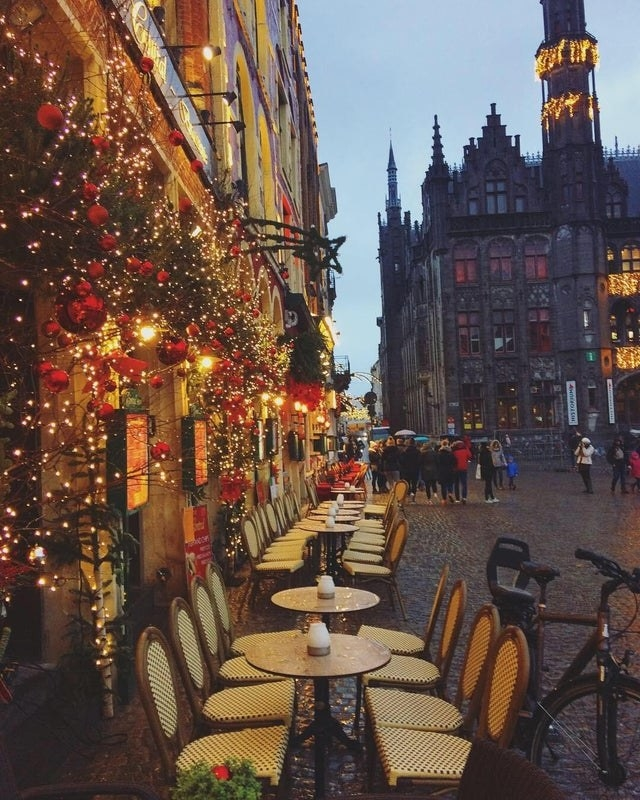 Christmas lights outside of a restaurant in Bruges