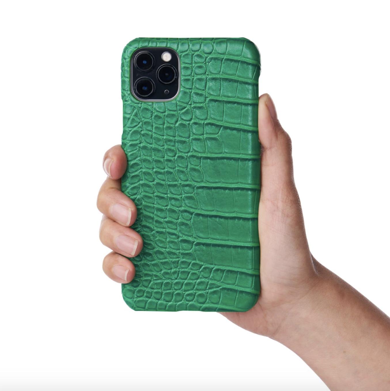 Model holding emerald green phone case