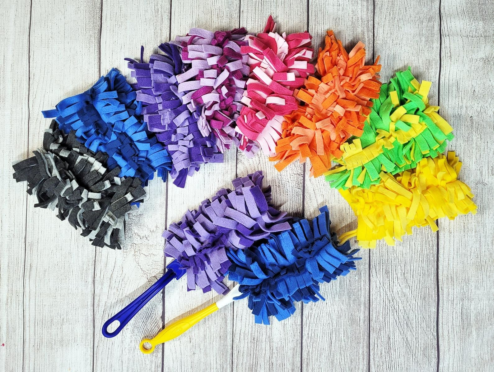 Set of reusable Swiffer dusters in various colors