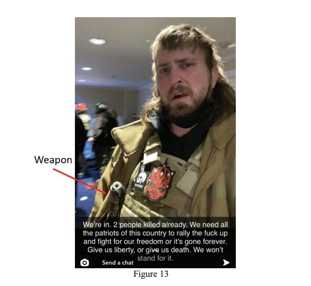 """The caption in a Snapchat screenshot reads """"We're in. 2 people killed already. We need all patriots of this country to rally the fuck up and fight for our freedom or it's gone forever."""" An arrow points to something under his sleeve, labeled """"weapon"""""""